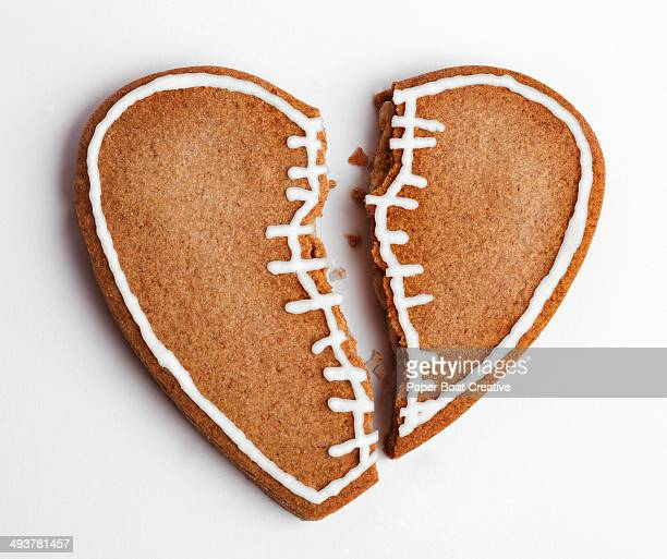 Cookie shaped as a broken heart with a stitch
