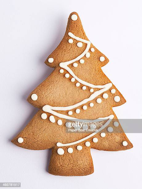 Cookie shaped as a Christmas tree with decoration