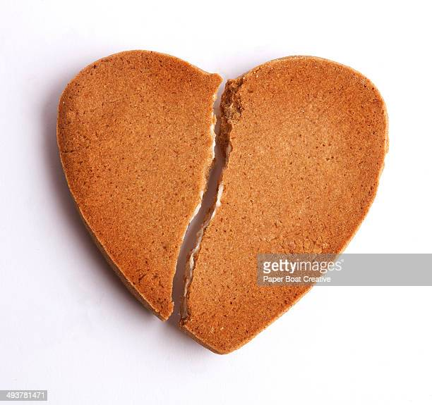 Cookie shaped as a heart with a crack
