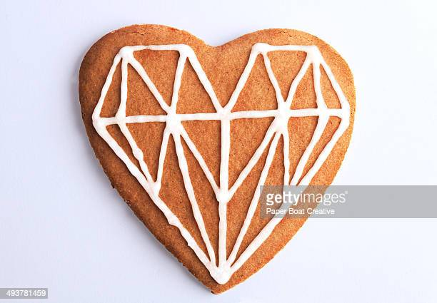 Cookie shaped as a heart with graphic design icing