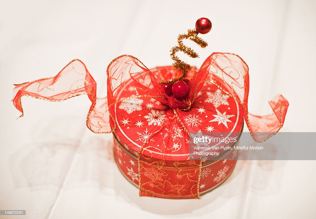Cookie tin with decorations : Stock Photo