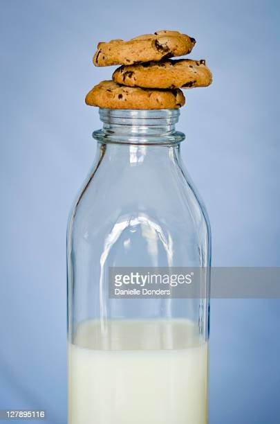 """cookies and milk bottle - """"danielle donders"""" stock pictures, royalty-free photos & images"""