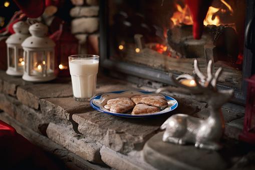 Cookies and milk, for Santa, left beside fireplace - gettyimageskorea