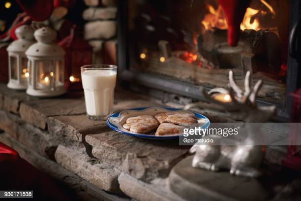 cookies and milk, for santa, left beside fireplace - santa close up stock pictures, royalty-free photos & images