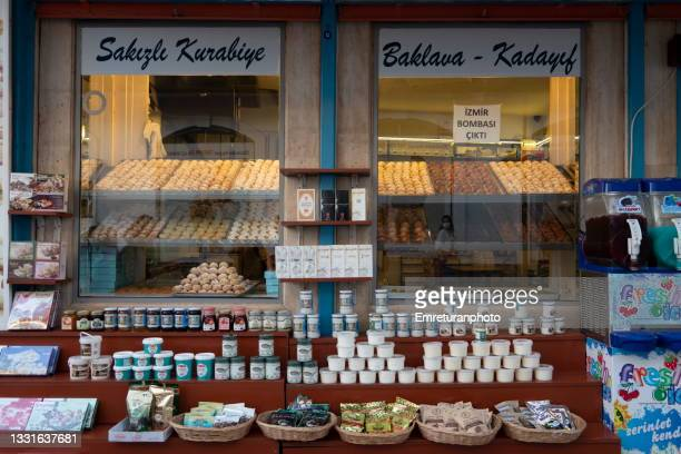 cookies and sweets on a stand in a shop window in downtown çeşme. - emreturanphoto stock pictures, royalty-free photos & images