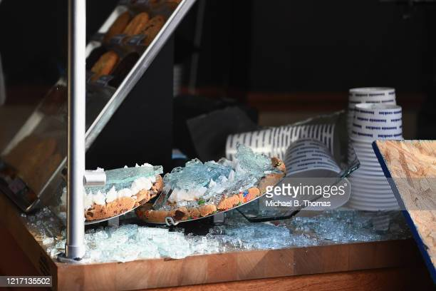 Cookies are seen covered in broken glass at an Insomnia Cookies store after overnight riots and looting on June 2 2020 in St Louis Missouri Four...