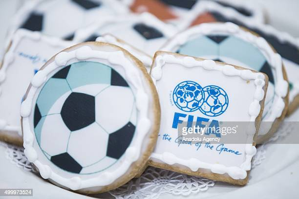 Cookies decorated with footballs the FIFA logo and Jordanian flag in honor Prince Ali bin Al Hussein FIFA Presidential hopeful speaking during a...