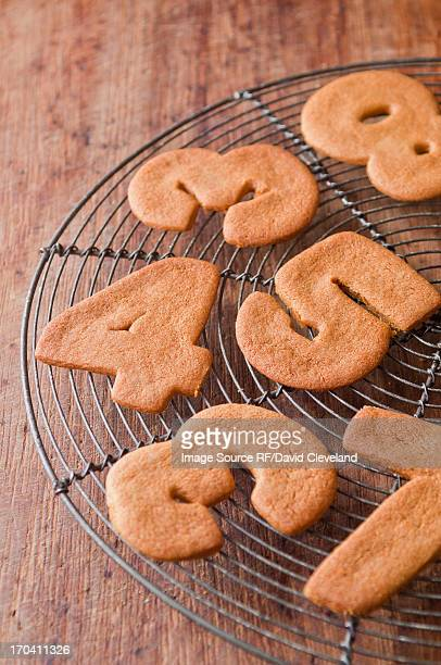Cookies in number shapes on cooling rack