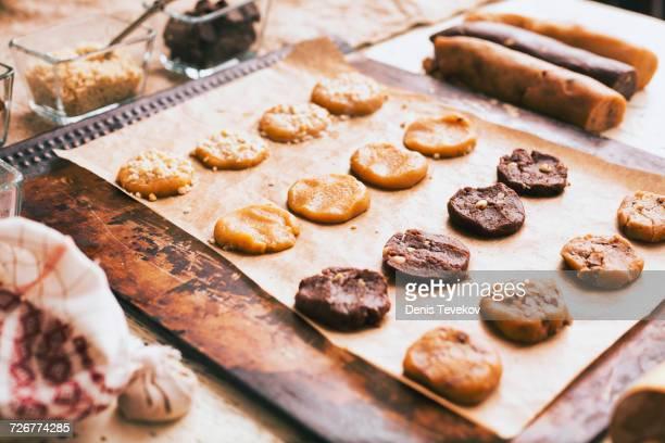Cookies on baking sheet near ingredients