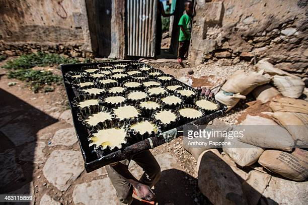 CONTENT] cookies ready to be baked in the oven in the alleys of the city of harar ethiopia