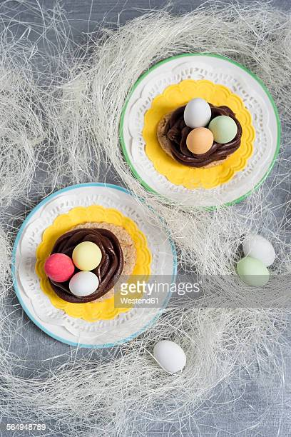 Cookies with chocolate ganache and sugared almonds in the shape of an Easter basket