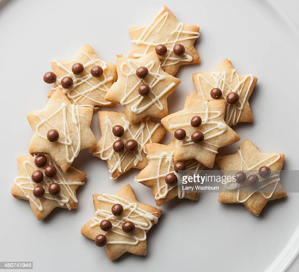Cookies with chocolate toppings and icing drizzle