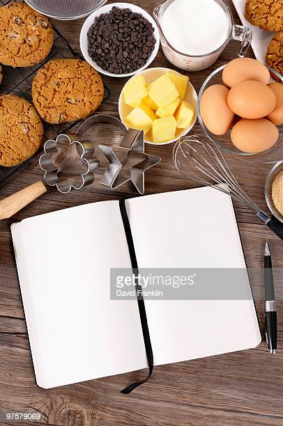 Cookies with ingredients and recipe book
