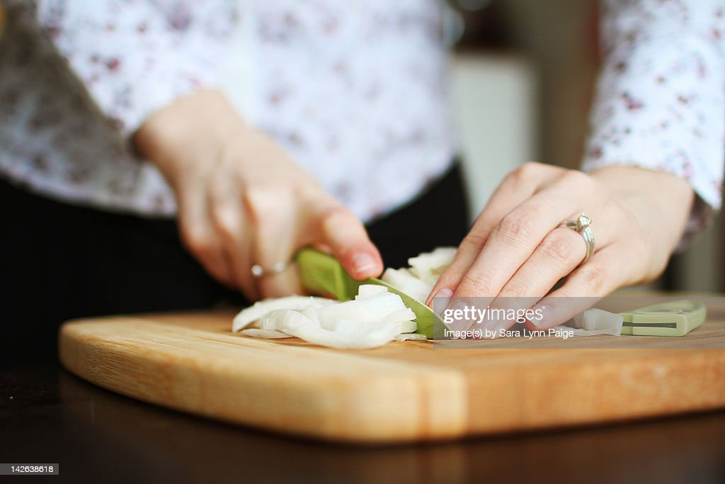 Cooking and chopping onions : Stock Photo