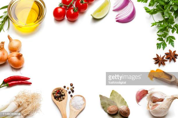 cooking and seasoning backgrounds: vegetables, herbs and spices frame. - condiment stock pictures, royalty-free photos & images