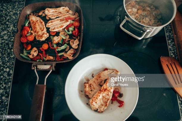 cooking  at home top view - carol cook stock pictures, royalty-free photos & images