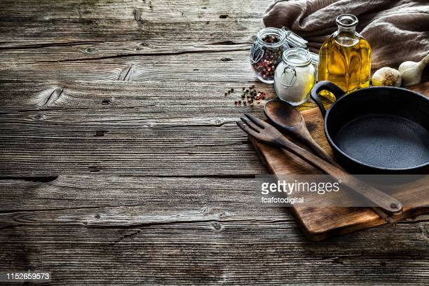 cooking backgrounds: cooking ingredients and utensils on rustic wooden table with copy space - copy space imagens e fotografias de stock
