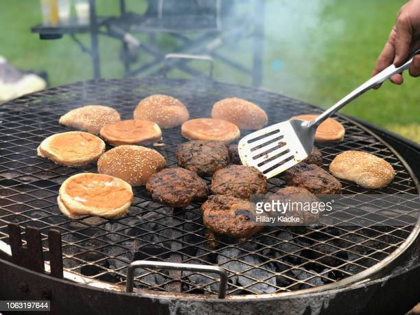 cooking burgers and buns on a grill - veggie burgers stock pictures, royalty-free photos & images