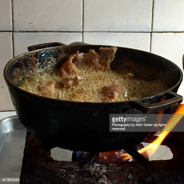 Cooking Chicken in Hot Oil on a Portable Natural Gas Stove