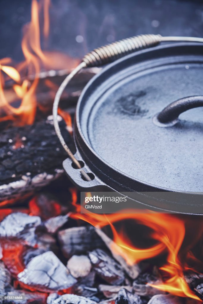 Cooking Chili Con Carne In Dutch Oven Over Logfire Stock