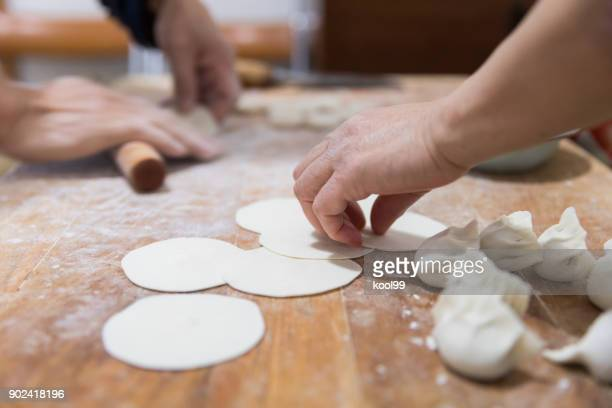 cooking chinese dumpling(jiaozi) - chinese language stock pictures, royalty-free photos & images