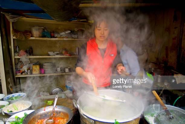 Cooking dumplings on Dazhalan Jie.