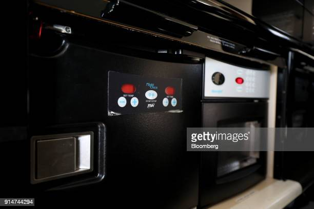 Cooking facilities are seen inside an Embraer SA Legacy 650E jet during the Singapore Airshow held at the Changi Exhibition Centre in Singapore on...