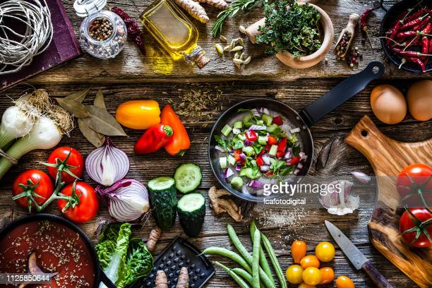 cooking fresh organic vegetables - veganism stock pictures, royalty-free photos & images