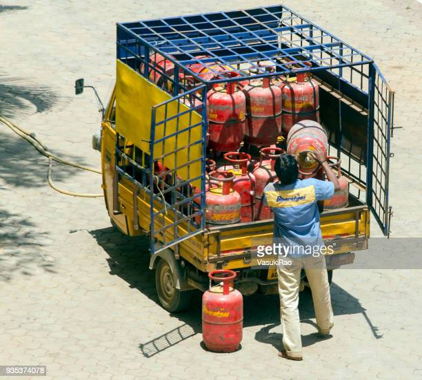 cooking gas supply, india - cylinder stock pictures, royalty-free photos & images