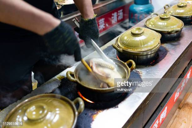 """cooking ginger duck called """"Jiangmuya"""" with casseroles"""