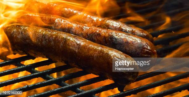 Cooking Hotdogs on a Flaming Barbecue Grill