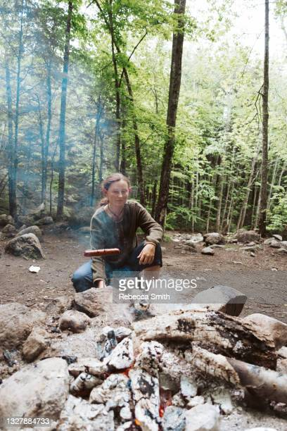 cooking hotdogs over fire - national forest stock pictures, royalty-free photos & images