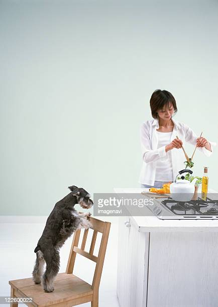 Cooking in kitchen with dog