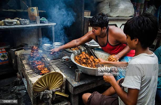 Cooking kebab at a roadside stall in north Kolkata.