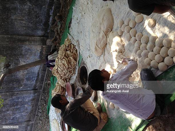 Cooking of Naan Bread in India.