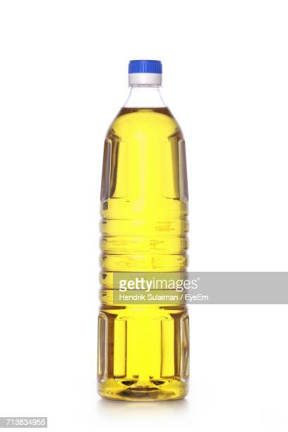 Cooking Oil In Bottle Against White Background