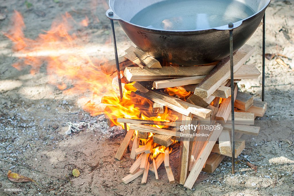Cooking on a fire. : Stock Photo