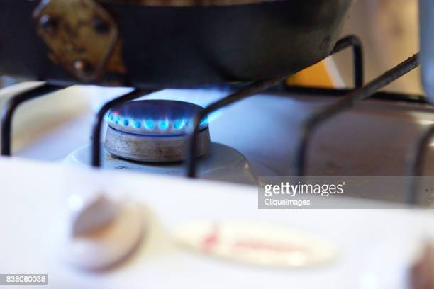 cooking on gas stove - cliqueimages stock-fotos und bilder