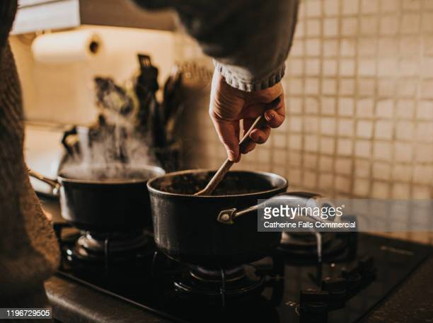 cooking - domestic life stock pictures, royalty-free photos & images
