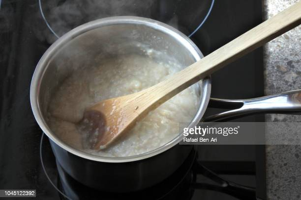 Cooking Pot Full with Porridge Cooked for Breakfast on a Stove