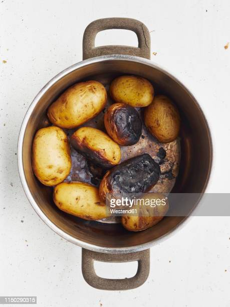 cooking pot of burnt potatoes - boiled stock pictures, royalty-free photos & images