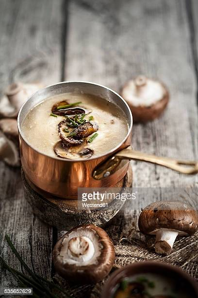 Cooking pot of mushroom cream soup with chive and fried mushroom
