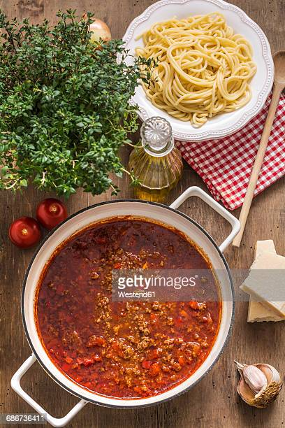 Cooking pot of Sauce Bolognese and bowl of cooked Spaghetti