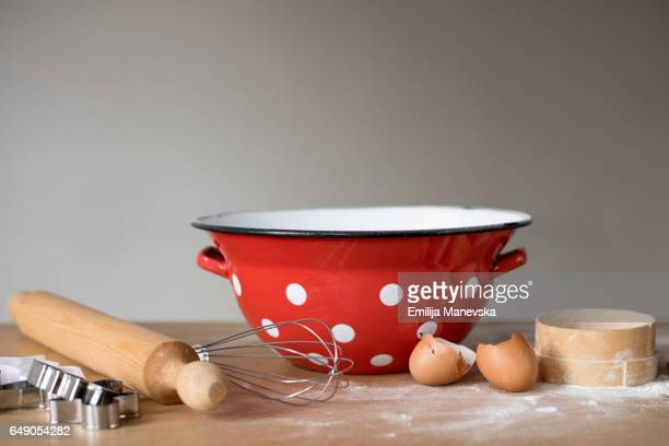 Cooking pots and baking utensils on table