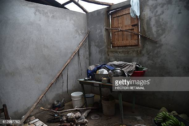 Cooking pots are seen in a destroyed house after the passing of Hurricane Matthew in Sous Roche in Les Cayes Southwest Haiti on October 6 2016 The...