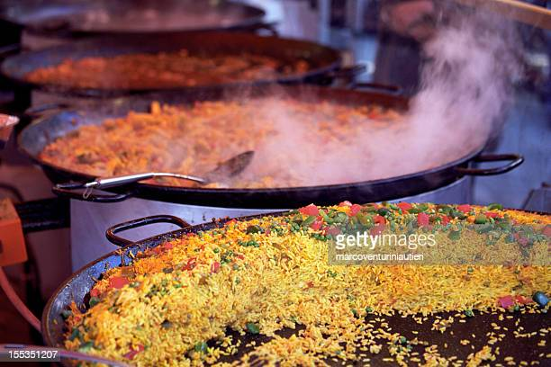 Cooking Spanish paella at an outdoor street market