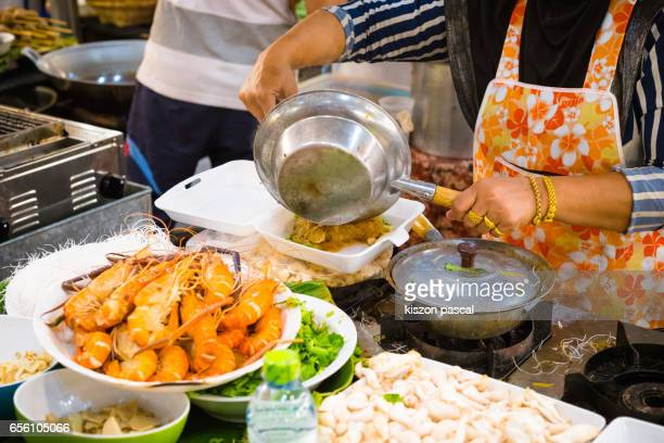 Cooking street food in a night market of Bangkok  , Thailand , Asia