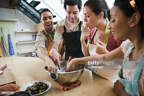Cooking students tasting batter
