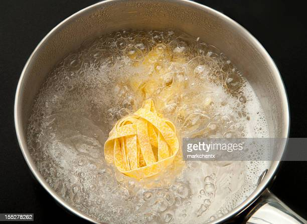 cooking tagliatelle - boiling stock pictures, royalty-free photos & images