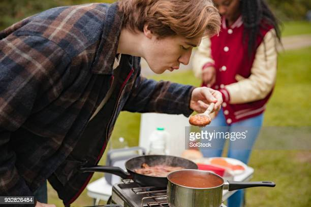 Cooking The Beans And Bacon